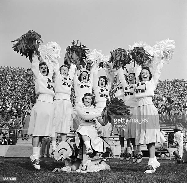 University of Maryland American football cheerleaders raising a shout for their team