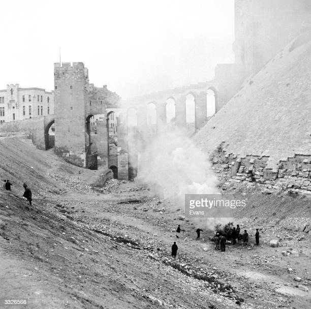 Viaduct between the Citadel and the city of Aleppo It was built by the Romans In the foreground workers burn garbage making Aleppo one of the...