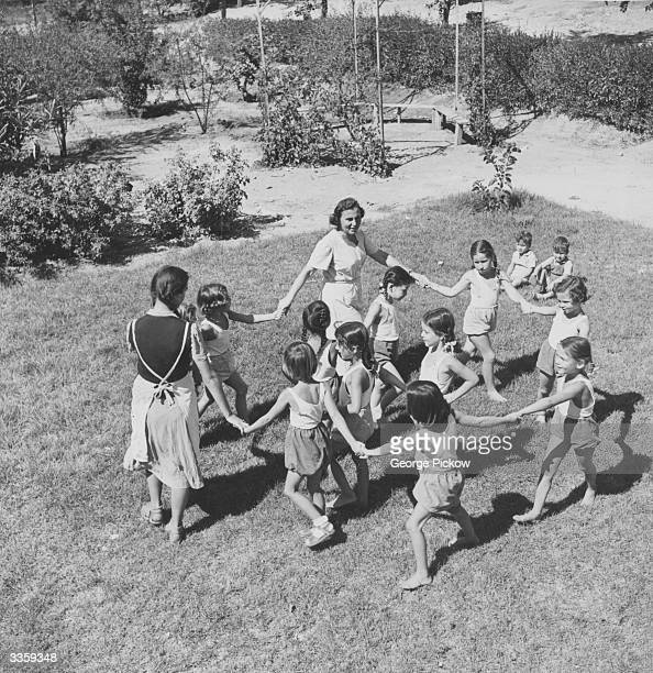 While their parents are at work in various industrial and agricultural tasks children on an Israeli kibbutz are cared for by trained guardians