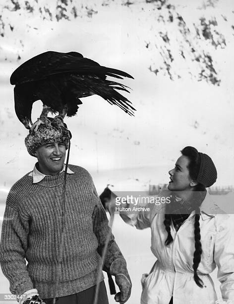John McCallum stands with Nadia Gray during production of the film 'Valley Of Eagles' directed by Terence Young for Independent Sovereign He has a...