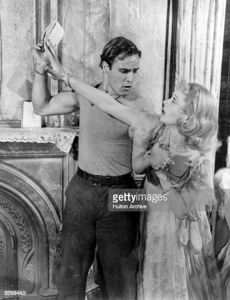 Marlon Brando and Vivien Leigh in a violent and emotional scene in 'A Streetcar Named Desire', adapted from the play by Tennessee Williams and...