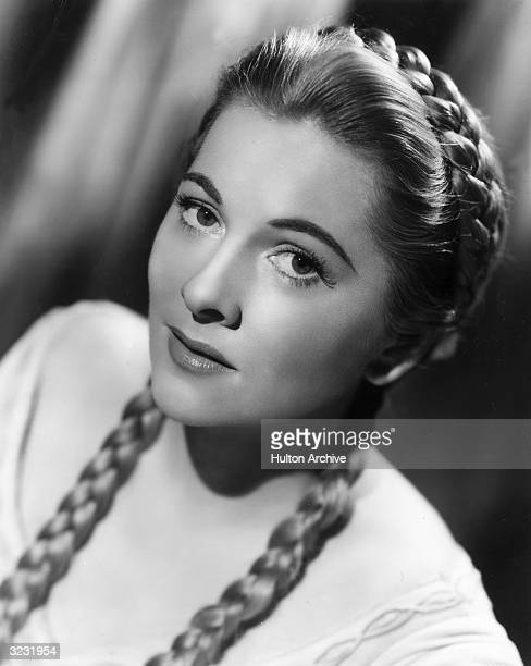 Promotional studio headshot portrait of American actor Joan Fontaine wearing her hair in long braids for her role in director Richard Thorpe's film...