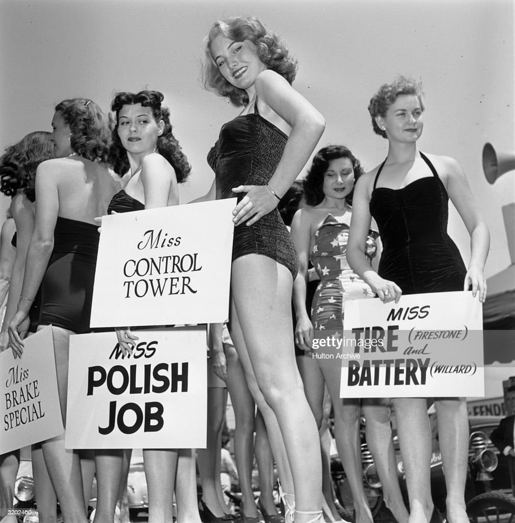 circa-1951-young-swimsuitclad-women-hold
