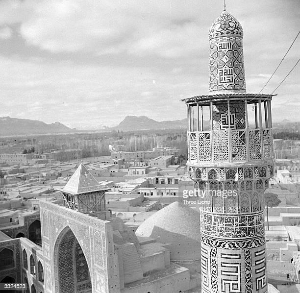 Mosaic-covered minaret rises from the mosque of Ali-Chapou in Isfahan the former capital of ancient Persia.