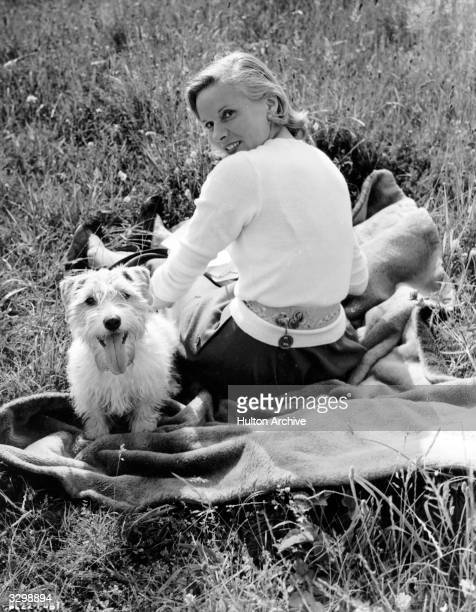 Ann Todd the blonde British actress who was married to director David Lean She takes a seat in the sun with her Sealyham terrier Whisky during the...