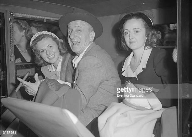 From l to r; Margie Little, comedian Jimmy Durante and Lorraine McDermott passengers in the back of a car. Jimmy Durante married Margie Little in...