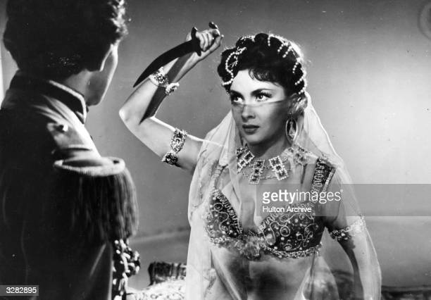 Gina Lollobrigida the Italian glamour girl and leading lady is with Gerard Philipe the French actor in a scene from the film 'Les Belles De Nuit'...