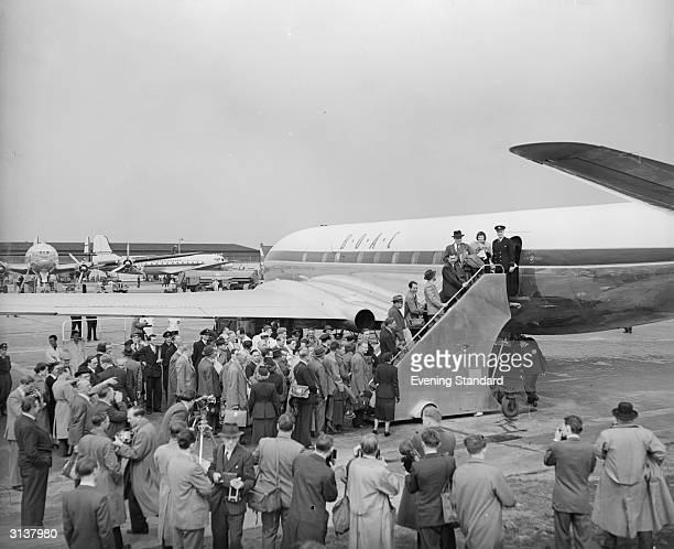 Passengers at London Airport boarding the BOAC Comet on the first commercial jet flight