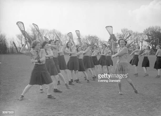 Senior schoolgirls practising the 'throw' in lacrosse