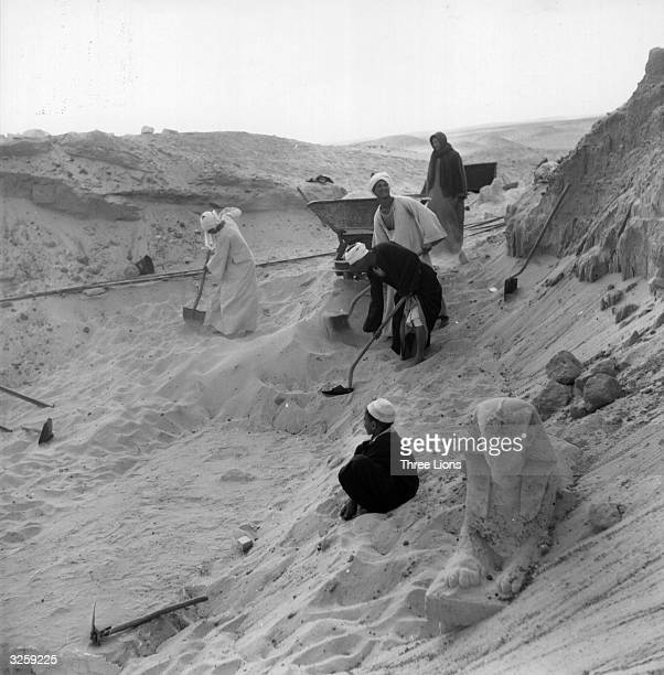 Workers excavating in the region three miles from the Nile on the border of Libya at a place called Sakkara the necropolis of ancient Memphis...