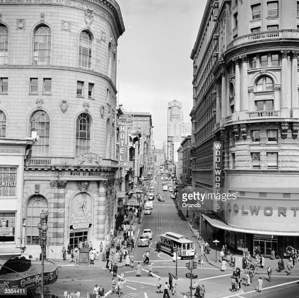 A junction at the bottom of one of the hills of San Francisco with a cable car terminus and a Woolworth's store