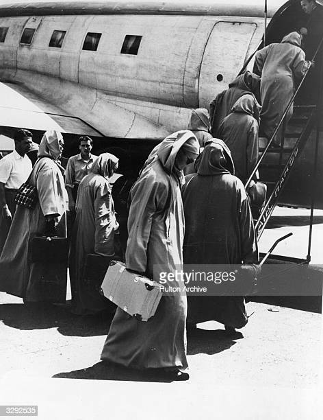 Concubines board an aeroplane at Rabet Airport after Sidi Mohammed Ben Youssef the Sultan of Morocco was deposed He was reinstated in 1955
