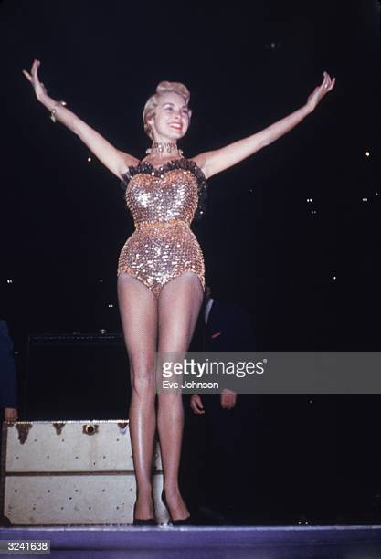 EXCLUSIVE Fulllength image of American actor Janet Leigh dressed in a sequined costume and fishnet stockings as a magician's assistant during a...