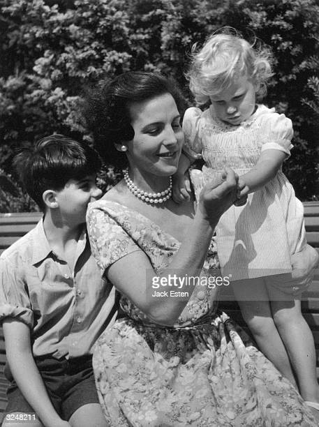 Princess Liliane of Belgium with her children Prince Alexandre and Princess MarieChristine in the grounds at Laken