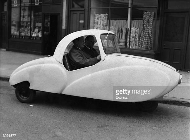 A new 'People's Car' with an entirely plastic body designed to seat three adults and two children and marketed as the cheapest car on the road