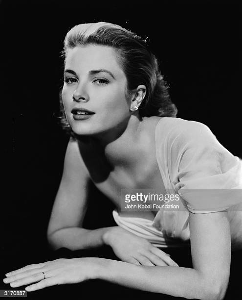 American actress Grace Kelly wearing an offtheshoulder dress