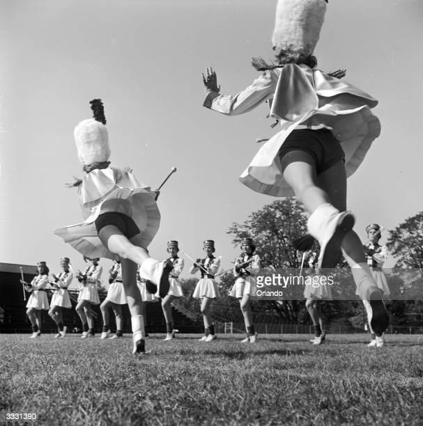 American high school majorettes lead the baton twirlers a special routine