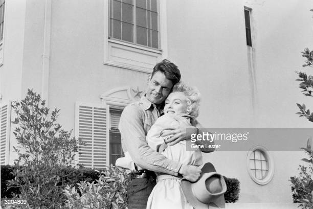 EXCLUSIVE American actors Don Murray and Marilyn Monroe smile while embracing on the set of director Joshua Logan's film 'Bus Stop' Monroe wears an...