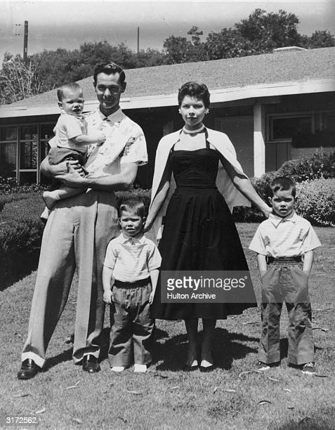 Fulllength portrait of American comedian and television show host Johnny Carson his wife Jody Wolcott and their three sons standing in the front yard...