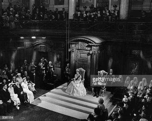 HM Queen Elizabeth II in her Coronation gown with the Duke of Edinburgh inside the Parliament House Wellington New Zealand during the State Opening...