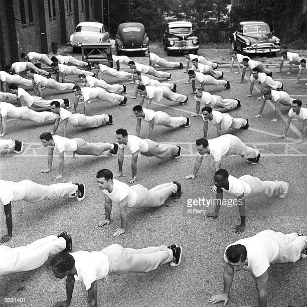 Rookie police patrolmen at an American police academy work out daily to get into the top physical condition necessary for their work