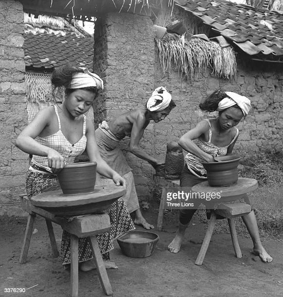 Women turning pots by hand in Bali The pottery is not very durable because it is fired at a low temperature