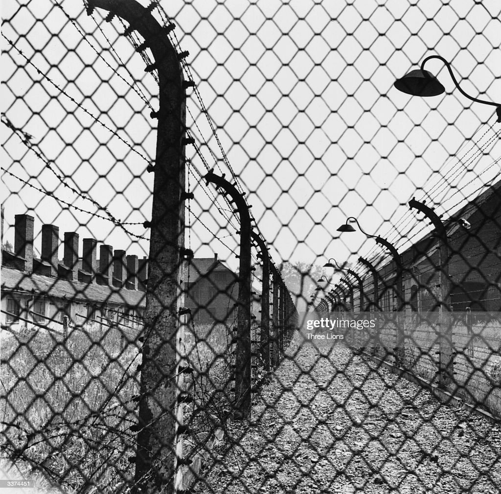 A barbed fence surrounding the German concentration camp at Auschwitz.