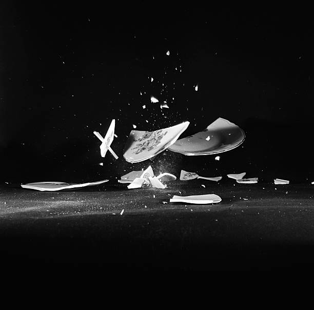 A china plate breaks into large pieces and tiny shards...