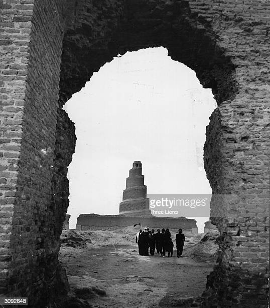 A circular stepped tower seen through a broken archway is said to be similar in appearance to the Tower of Babel and located in the same area