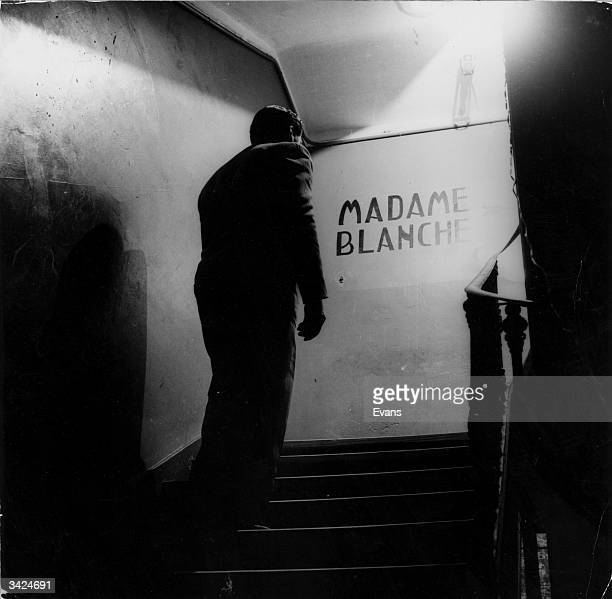 A client climbing stairs to visit prostitutes in Madame Blanche's establishment in Tangiers The establishment is registered as a legitimate 'house'...