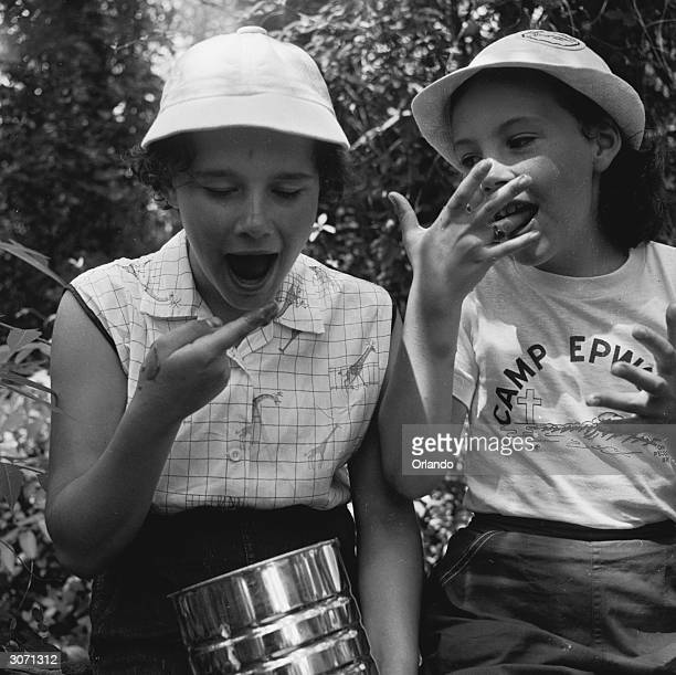 A couple of girls eating jam during a church camp at Camp Epworth Jamesport Long Island