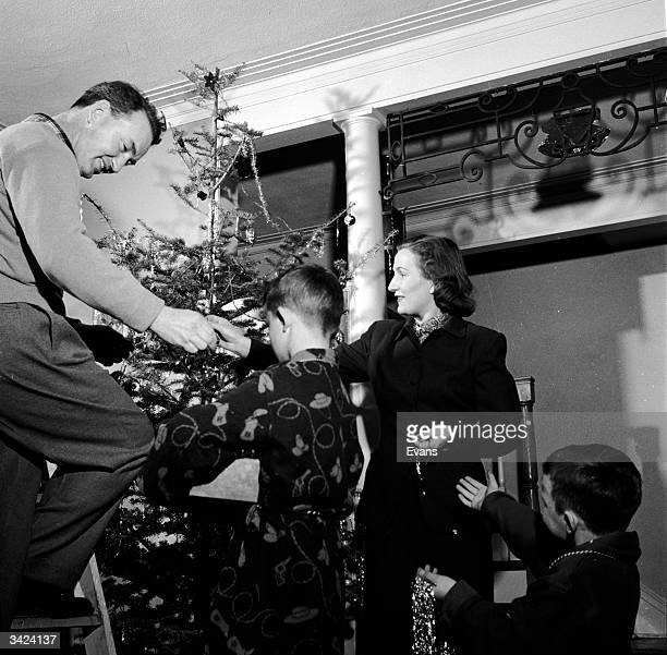 A family decorating their Christmas tree