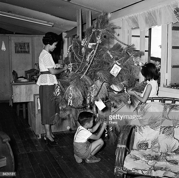 A family in the Philippines decorating their Christmas tree