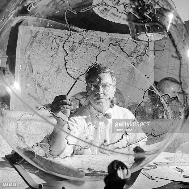 A geographer employed by the Farquhar company at Philadelphia at work on a four dimensional world