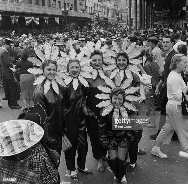 A group of girls in sunflower costumes at the New Orleans Mardi Gras parade The festivities take place in the week before Lent