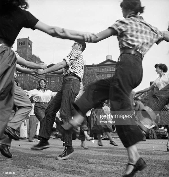 A group of revellers jive dancing in Washington Square Park Greenwich Village New York