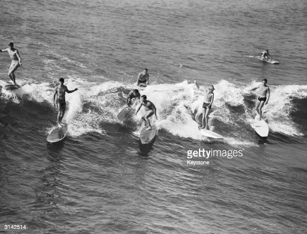 A group of surfers from the Hermosa Beach Surf Club in California practising for a competition Left to right Bill Edgar Dave Perumian Olie Scrivens...