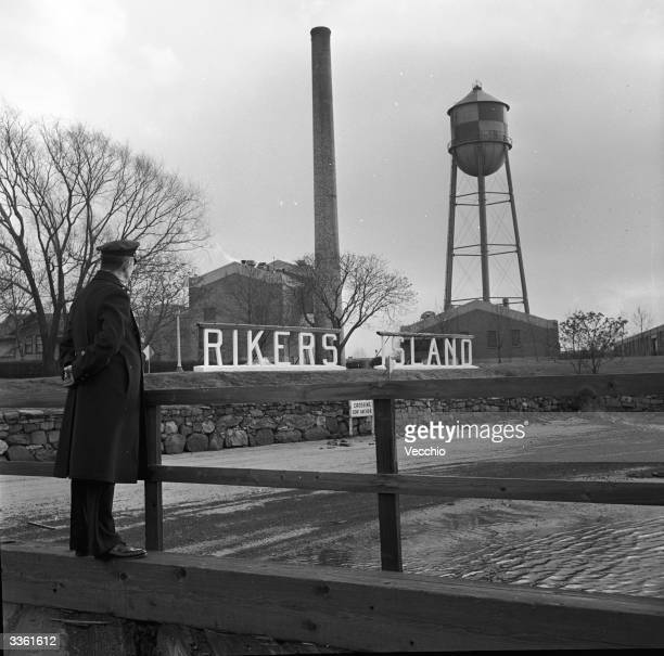 A guard at the entrance to Rikers Island penitentiary New York