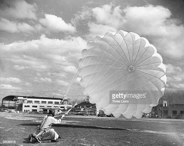 A man landing with a nylon parachute a fibre far superior in strength and durability to the original parachute material silk