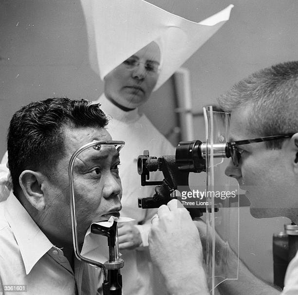 A patient at the US Public Health Service Hospital Carville LA having his eyes examined This hospital for leprosy sufferers is run by nuns