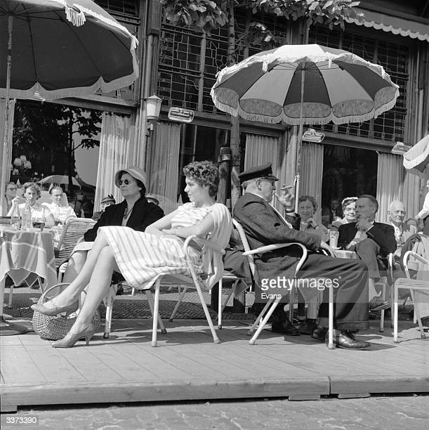 A popular street cafe in the Dutch city of Haarlem becomes busy as people take advantage of the spring sunshine