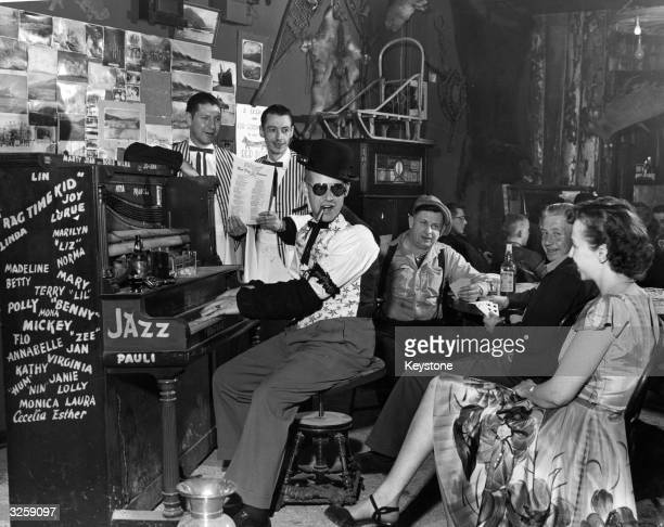A pub jazz pianist entertaining locals at the Red Dog Saloon