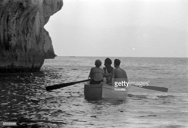 Rowing boat approaches the Isle of Capri's famous 'Grotta Azzurra' or Blue Grotto.
