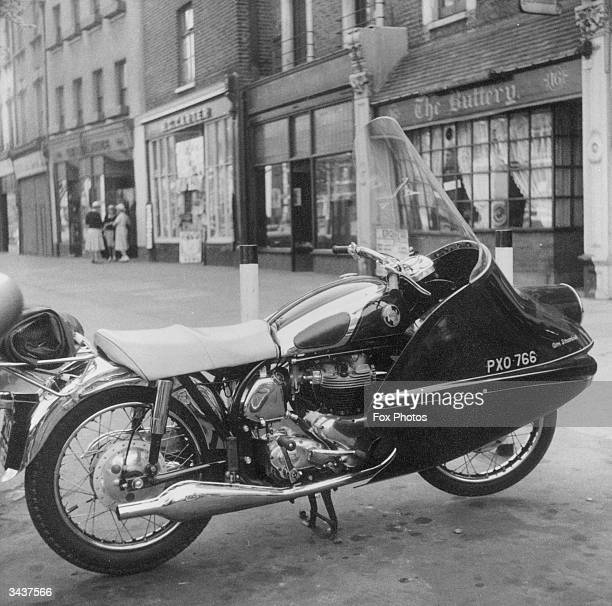 Shiny new Norton motorcycle with twin carburettors, a full fibreglass 'Avon streamliner' fairing, pigskin seat and chrome fittings. It can achieve a...