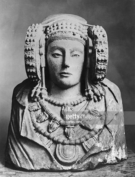 A Spanish bust of the Dama de Eleche with intricately carved representations of jewellery