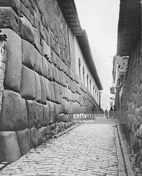 A street in Cuzco where houses are built on top of old Incan walls
