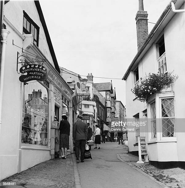 Street with a variety of shops in Lyme Regis, Dorset.