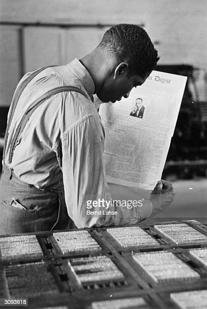 A student at Tuskegee University in Alabama learns to print a newspaper page in the Institute's printing works Booker T Washington an early principal...