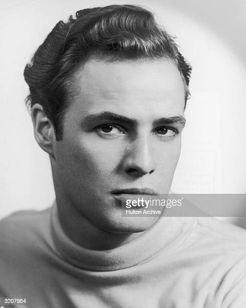 A studio portrait of actor Marlon Brando wearing a turtleneck sweater