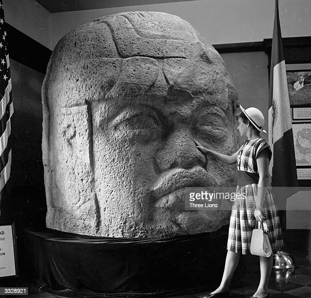 A typical Olmec head carving dating from 1100 BC on display in Washington DC's National Geographical Sociey museum